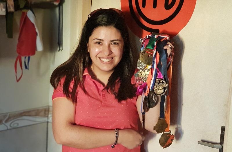 Orgullosa exhibe todas las medallas que ganó como corredora de Running Callejero, una de sus aficiones predilectas.